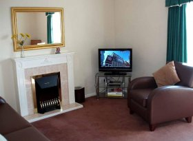 Lounge: Sofa, armchair, dining table & chairs. Freeview TV. DVD player. Wi-Fi