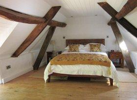 Galleried bedroom under the eaves