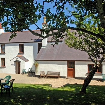 Find self-catering accommodation for Beautiful former farmhouse on the Pembrokeshire coast near Tenby - use of resort pool and spa