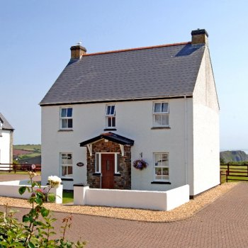 Find self-catering accommodation for A beautiful house with stunning headland views near Tenby, Pembrokeshire - use of resort pool & spa