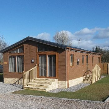 Find self-catering accommodation for Beautiful Woodland Lodge - New self catering family accommodation