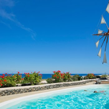 Find self-catering accommodation for Stunning 2-bedroom windmill villa in Santorini with private pool and panoramic sea view